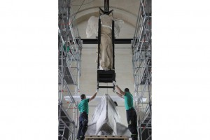 """Art movers maneuver the statue back into position. Musée du Louvre/Antoine Mongodin"" via the Wall Street Journal"