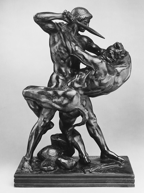 Black sculpture of Theseus slaying a minotaur.
