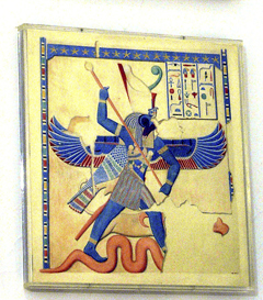 An image of a winged figure with hieroglyphics.