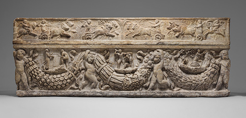 Marble sarcophagus with reliefs of humans, animals, and foliage.