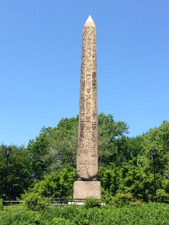 An obelisk inscribed with hieroglyphs.