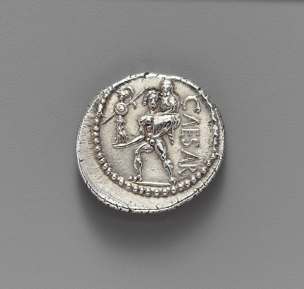 A silver coin depicting Julius Caesar.