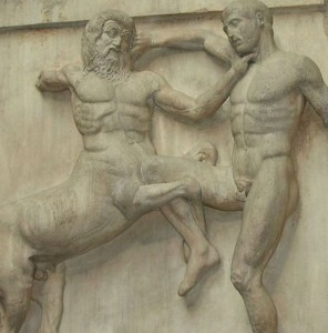 Sculpture of a centaur fighting a man in high relief.